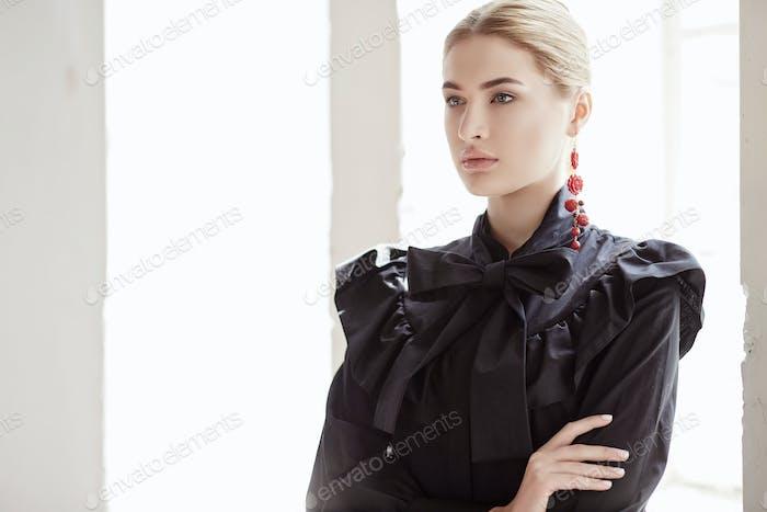 Female in a black dress.