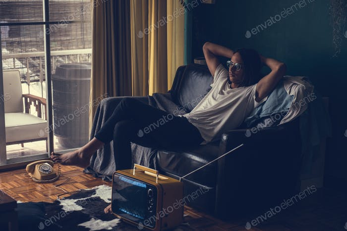 Hipster man sitting on a sofa