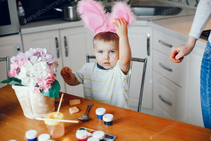 Little boy sitting in a kitchen
