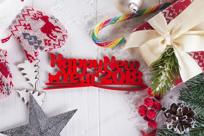 New year background with gift boxs, christmas tree, mittens and decorations
