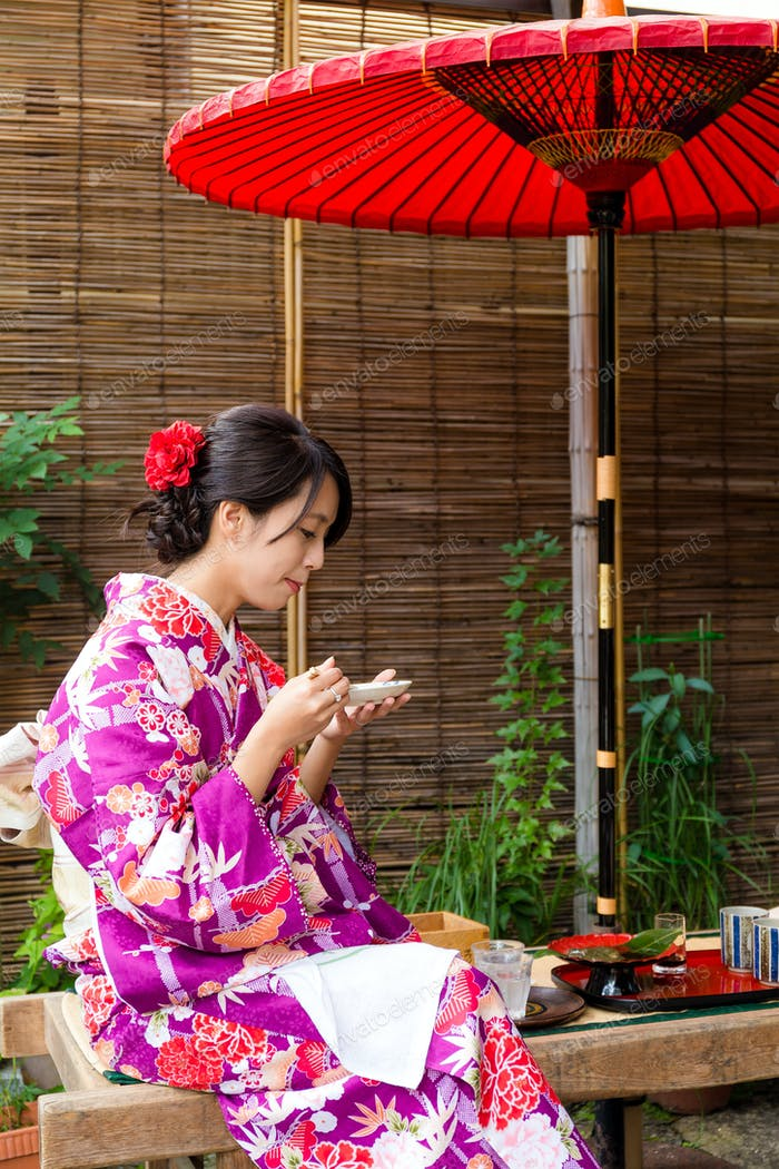 Young woman having the dessert in tea house