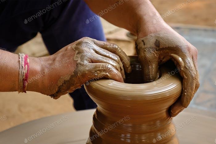 Indian potter hands at work, Shilpagram, Udaipur, Rajasthan, India