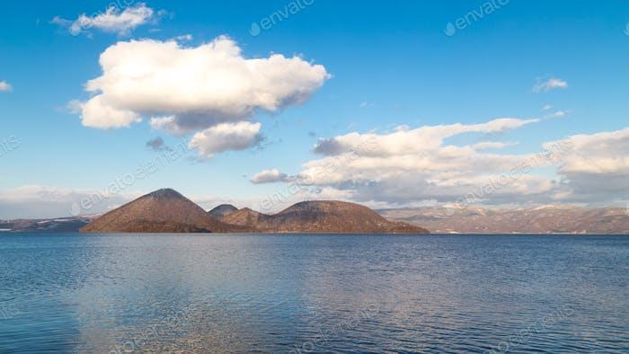 Scenic Lake Toya with Nakajima Island during winter in Hokkaido Japan