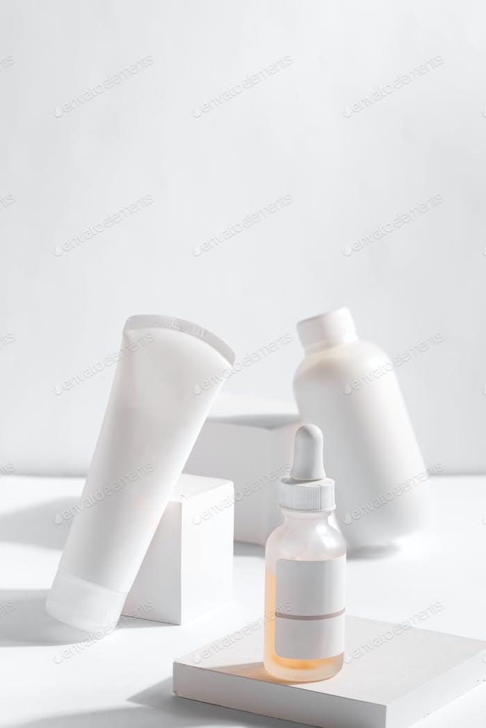 Set of cosmetic products in white containers on light background. Organic skincare