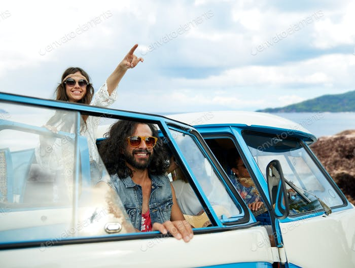 happy hippie friends in minivan car on island