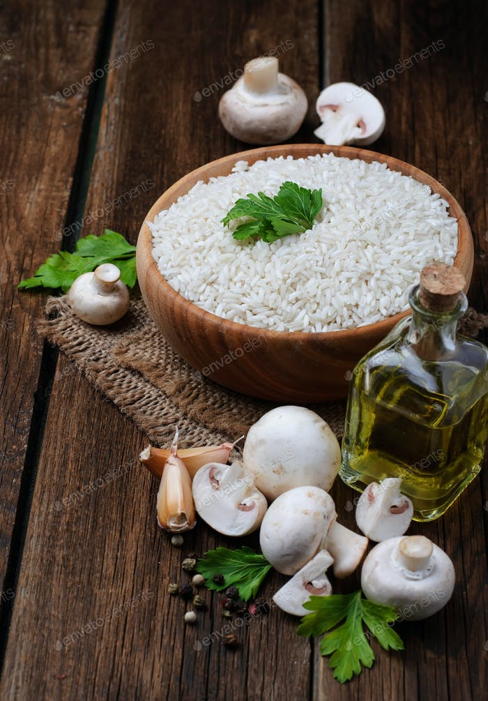 Ingredients for risotto: rice, mushroom, garlic, oil