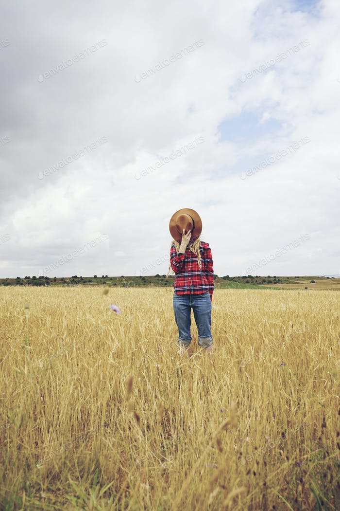 Unknown country woman in a field of wheat