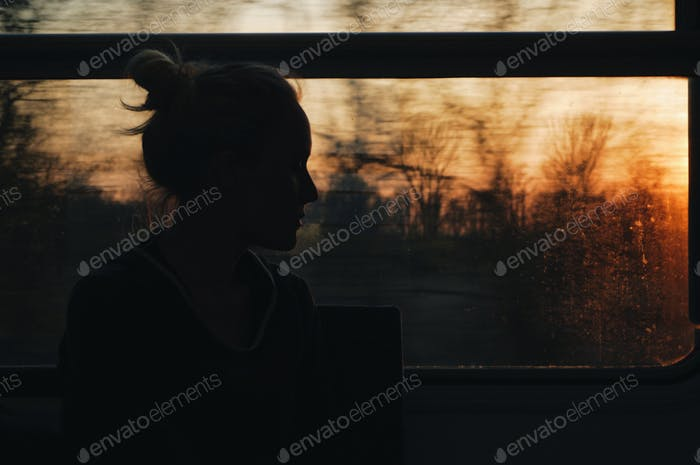 caucasian woman traveling by train