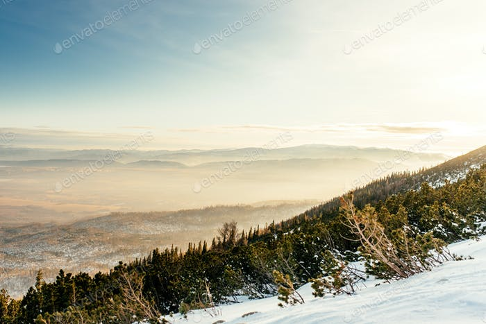 Mountain landscape during winter. Layers of mountains and valley from high cliff