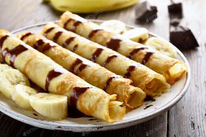 Crepes roll with banana slices