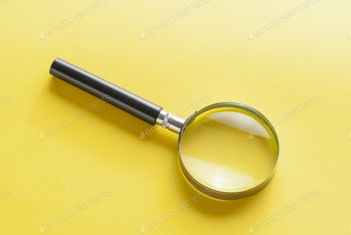 Magnifying glass with printed question mark