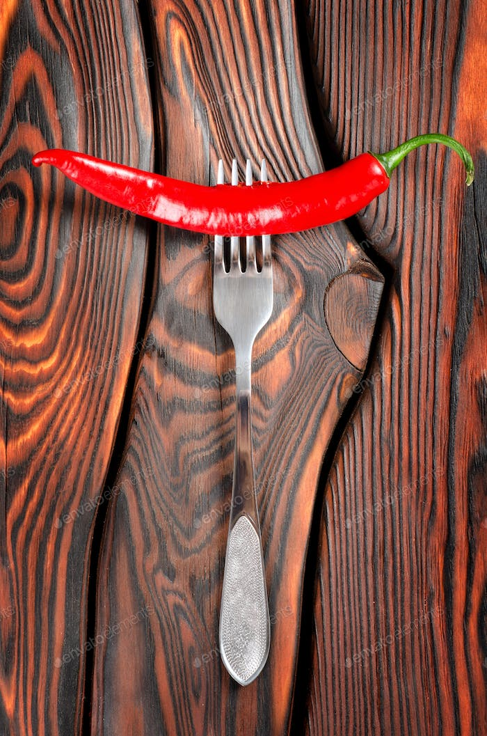 Red chili pepper and fork