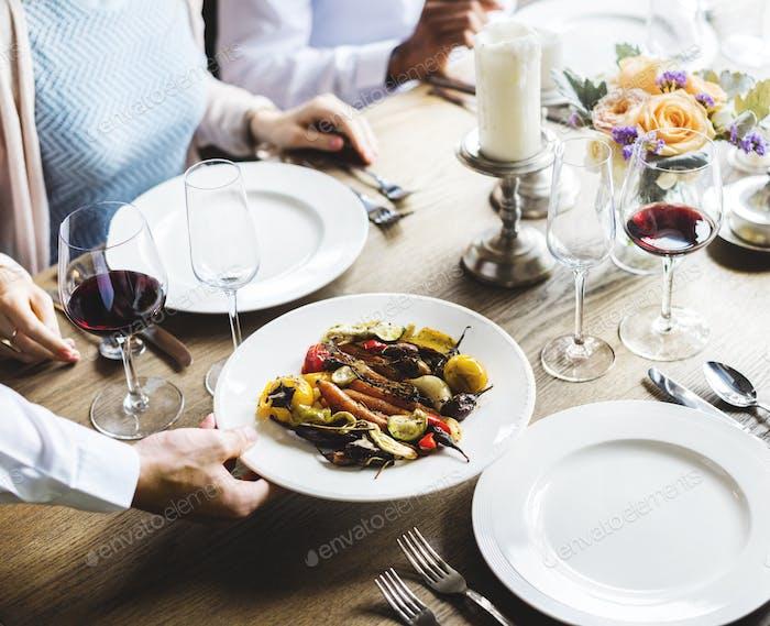 Waiter Serving Food Main Dish to Customers