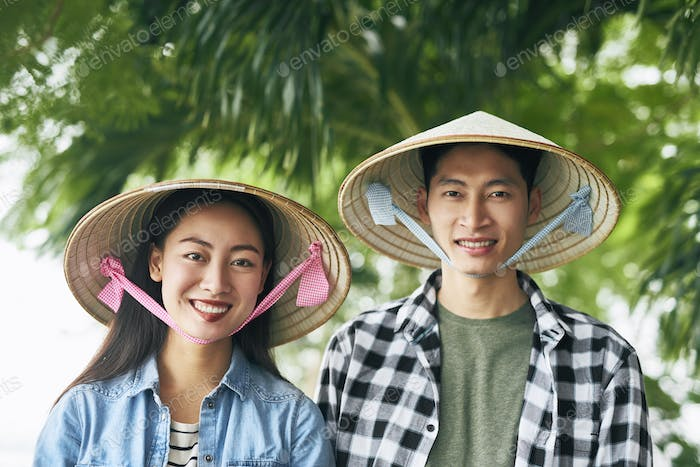 Portrait of Vietnamese couple looking at camera
