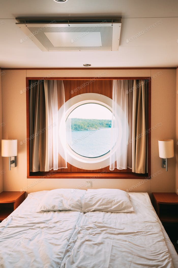 Ship Cabin With Bed And Window With View On Sea. Luxury Cabin On Ferry Boat Or Cruise Liner
