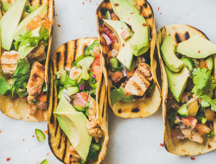 Gluten-free healthy corn tortillas with grilled chicken fillet, avocado, salsa
