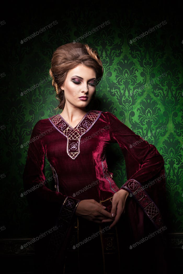 Gorgeous woman dressed in luxury vintage clothes in retro interi