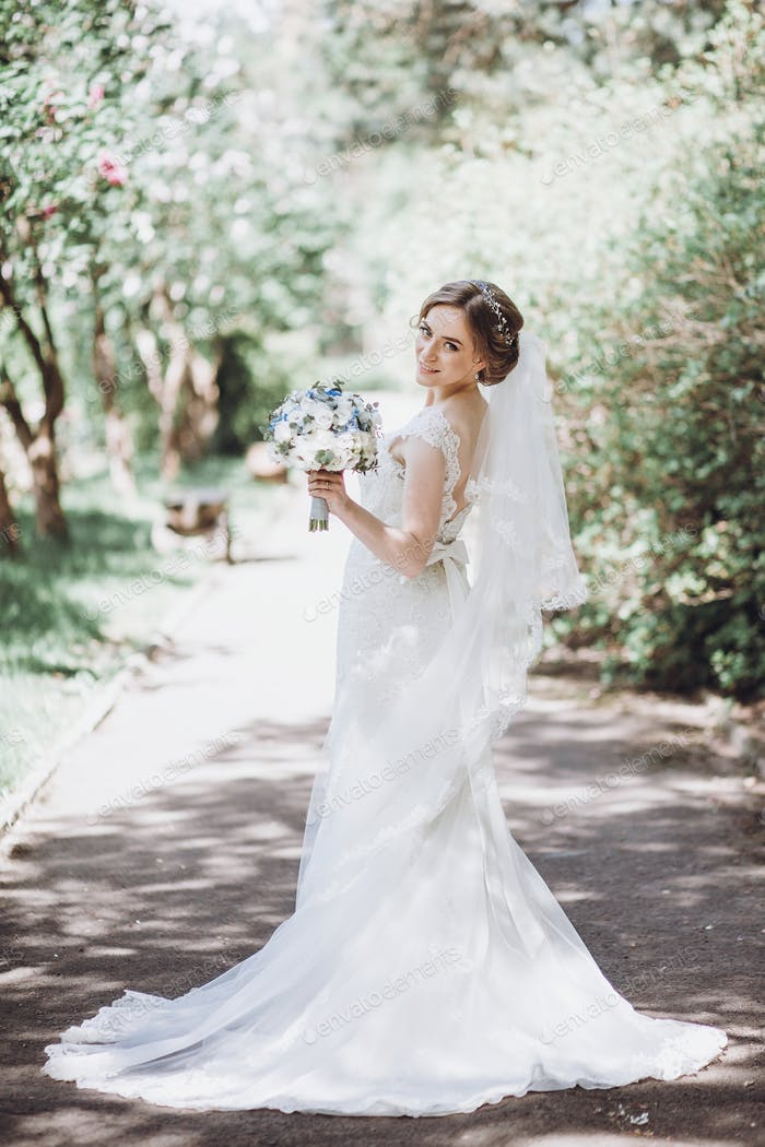 Beautiful blonde bride in elegant white wedding dress