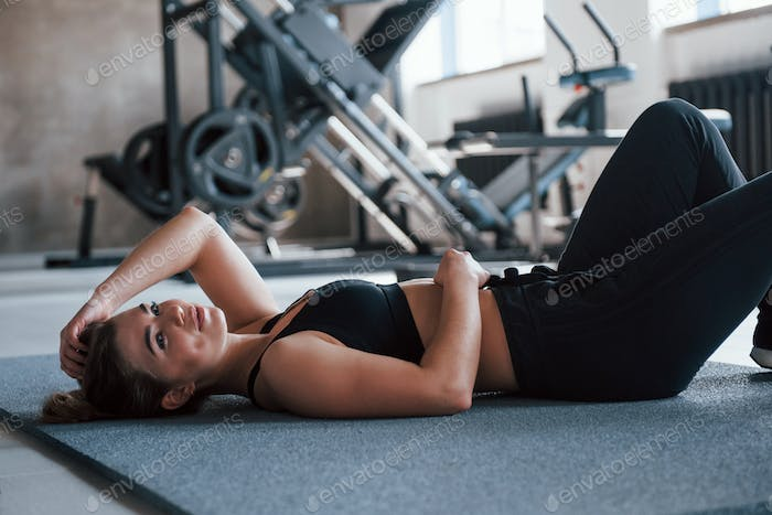 Portrait of gorgeous woman in the gym at her weekend time