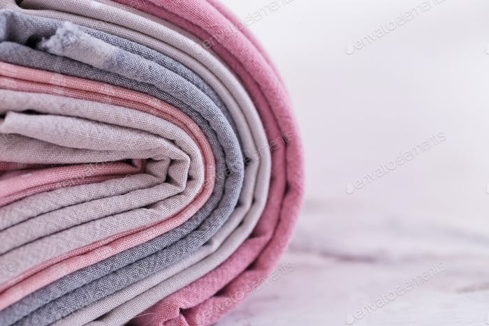 stack of fabrics over marble table