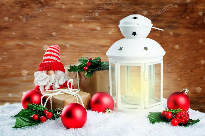 Christmas lantern with gifts, colored balls on a winter wood bac