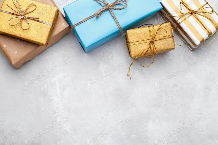Gift boxes on grey stone background