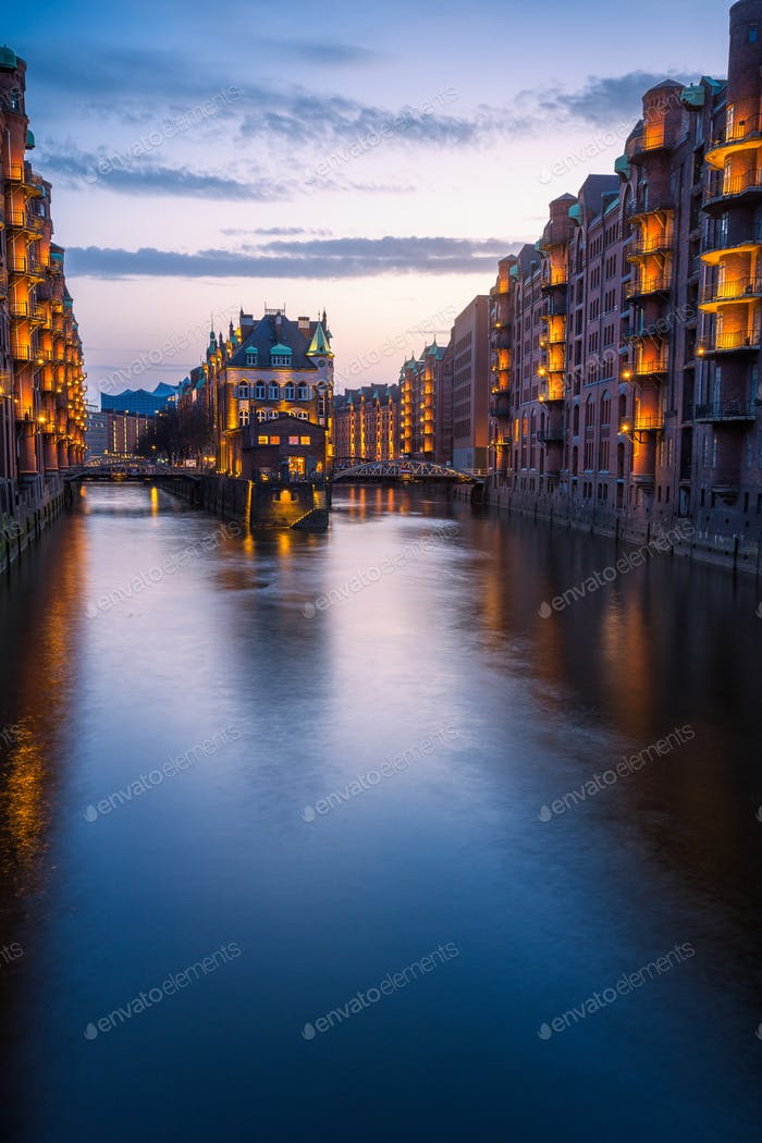 Hamburg city old port during blue hour, Germany, Europe. Historical famous warehouse district