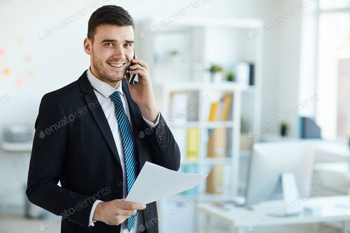 Banker with phone and paper
