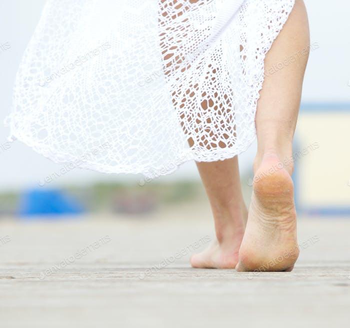 Barefoot woman walking away