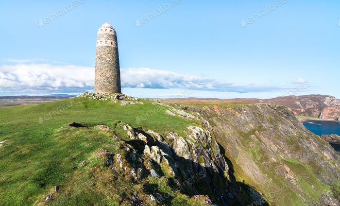 Large Rock Tower Monument on the Coast in Scotland