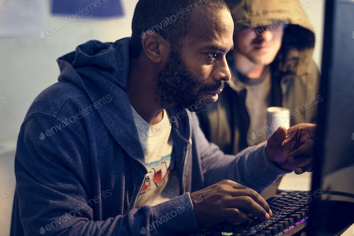 African descent man working with computer laptop