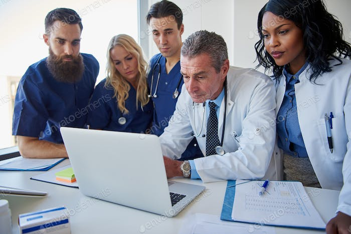 The medicine workers standing and browsing laptop