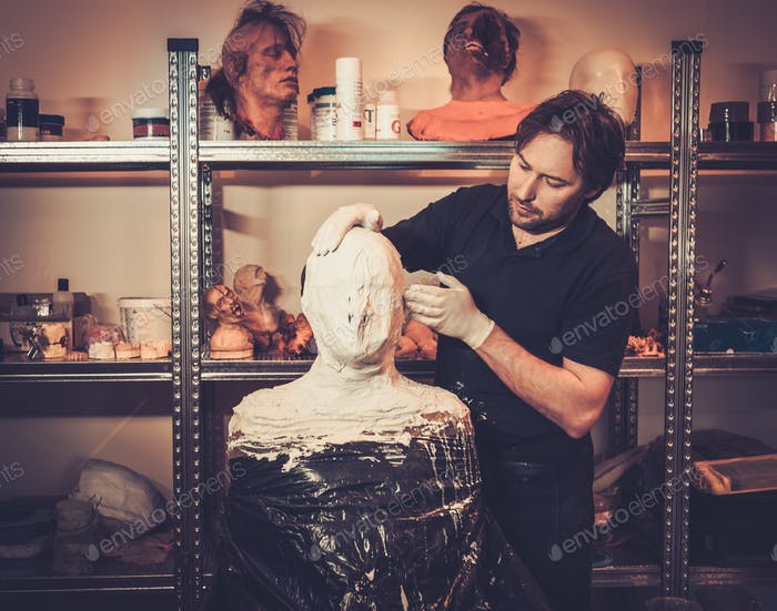 Men during lifecasting process in a prosthetic special fx workshop