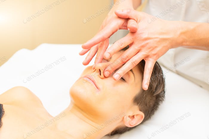 A relaxing beauty massage for a young woman with a nose detail