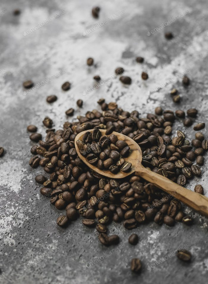 coffee beans in wood spoon with Grunge Background