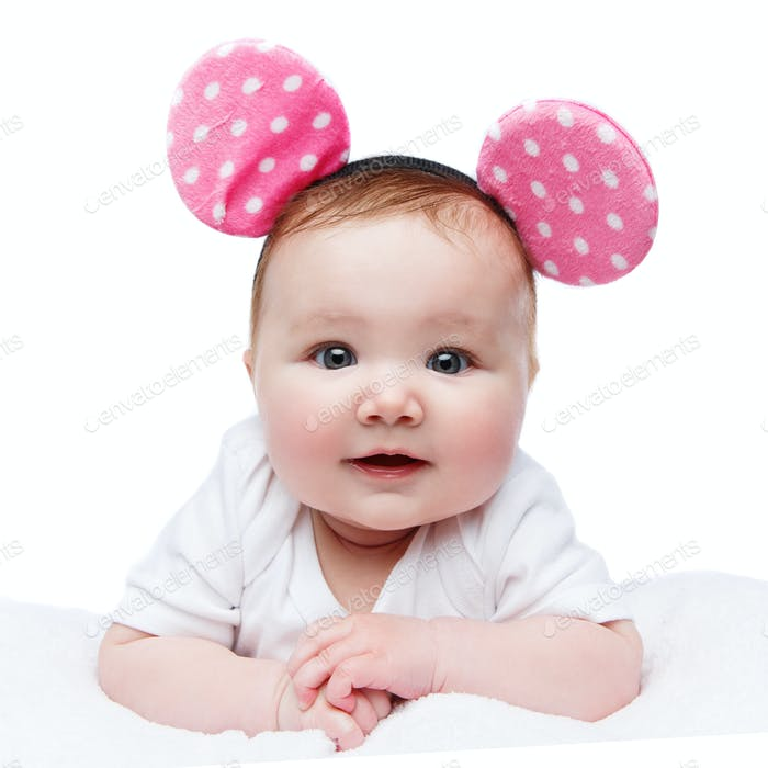 funny little baby girl in mouse ears headband
