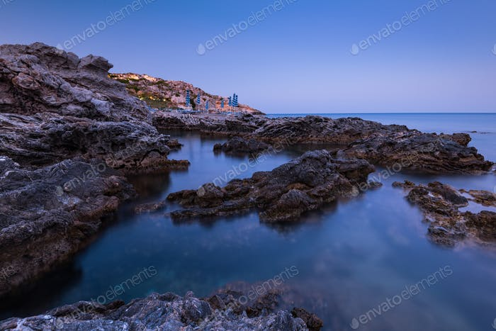 Twilight Over Rocky Beach and Cliffs at Rhodes Island,Greece