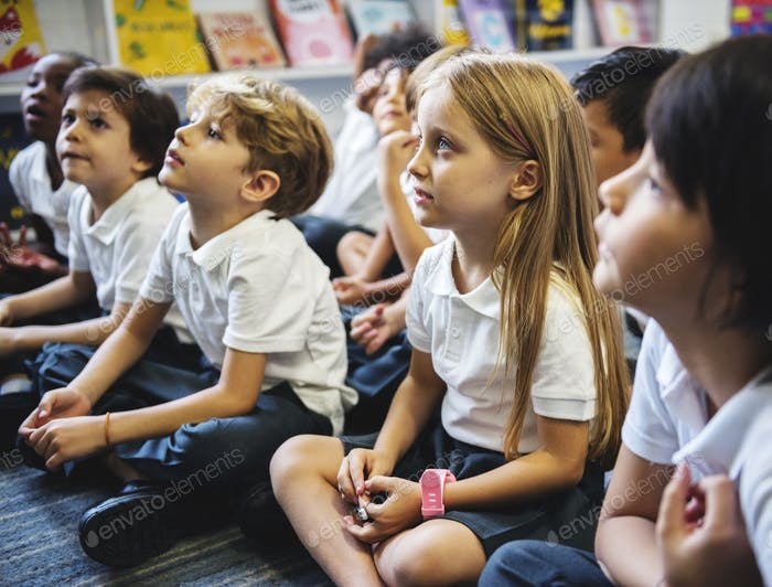 Kindergarten students sitting on the floor