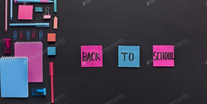 Pink and blue stickers with back to school text on chalk board
