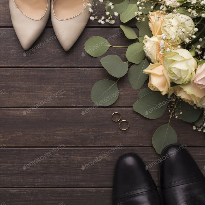 Bride groom shoes and wedding small bouquet of roses