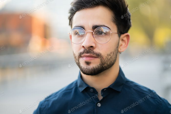 Close-up of young man outdoors.