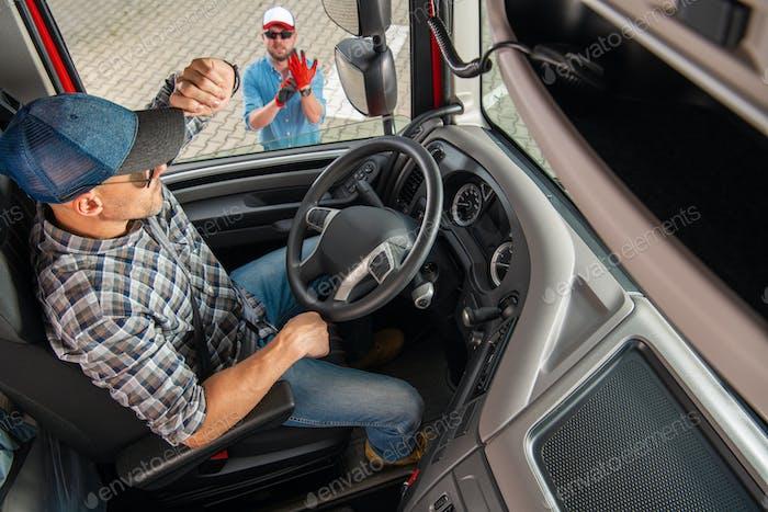 Semi Driver Talking to His Truck Dispatcher