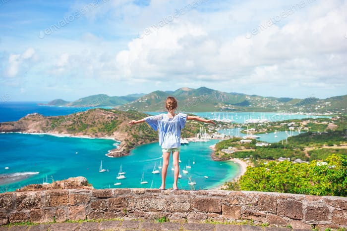 Little adorable kid with beautiful famous view. View of English Harbor from Shirley Heights, Antigua