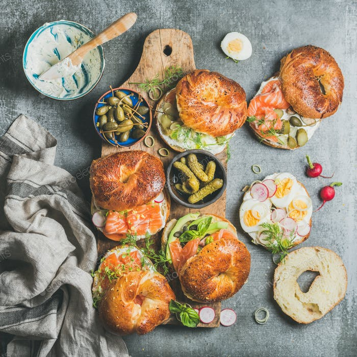 Variety of bagels with vegetables, salmon and cream cheese