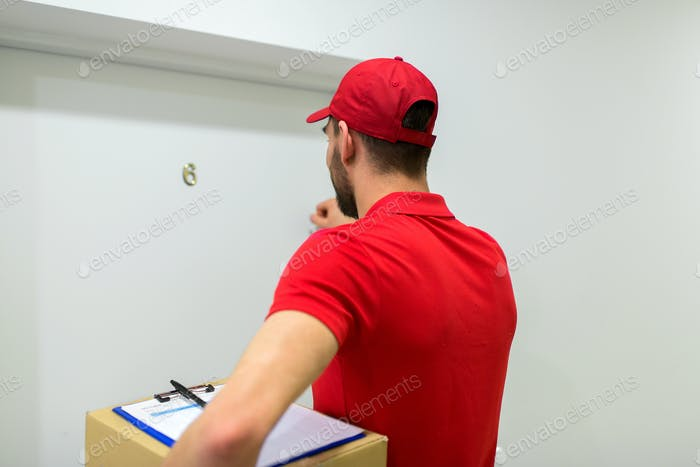 delivery man with parcel box knocking door