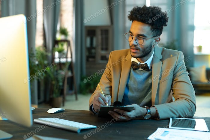 Man at business meeting online