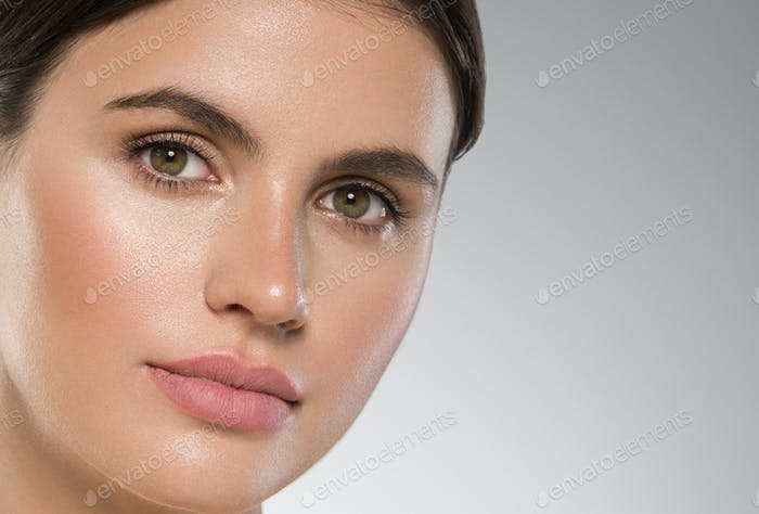 Woman face close up beauty macro eyes lips skin tone