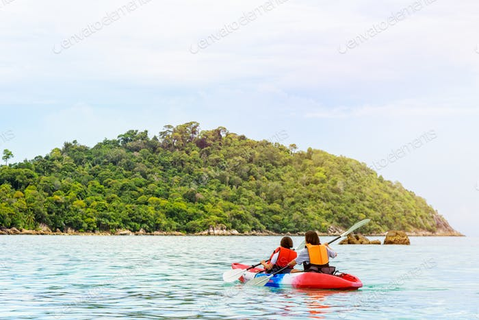 Mother and daughter travel by kayak at Ko Lipe, Thailand