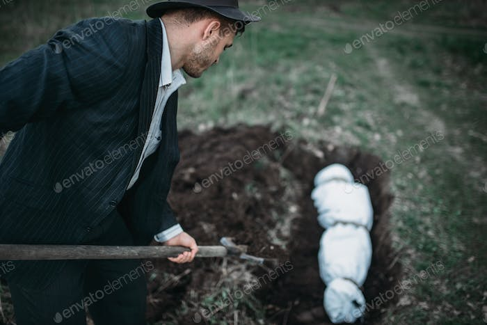 Maniac buries victim into a grave, crime horror