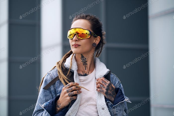 Portrait of neo punk styilish girl in interesting glasses